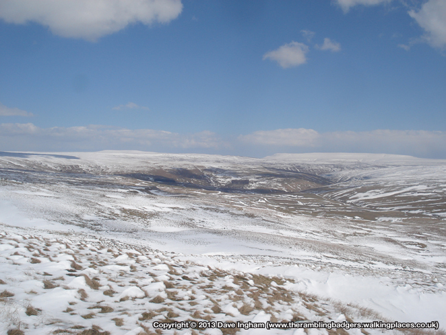 The flat top of Buckden Pike seen behind Birks Fell, and Great Whernside to the right of shot